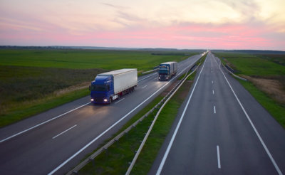 Goods delivery by roads. Services and Transport logistics. Soft focus, possible granularity.