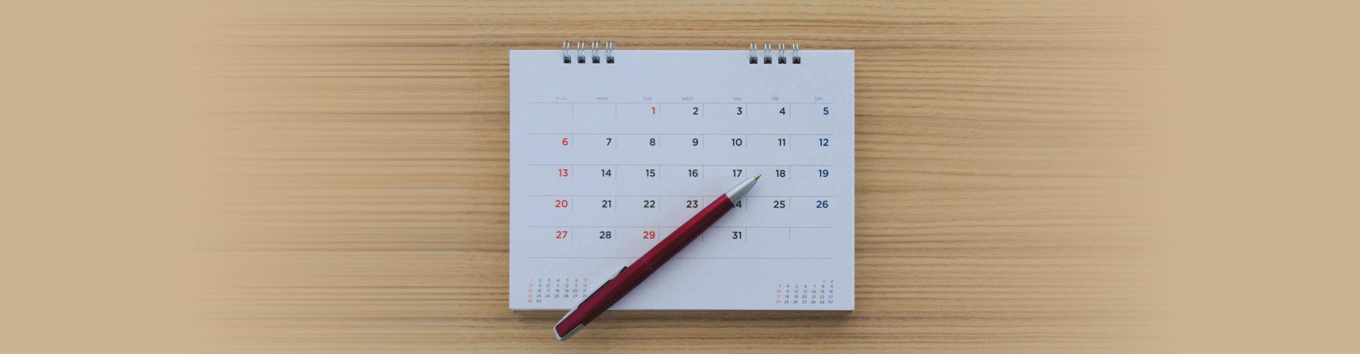 pen on top of a calendar